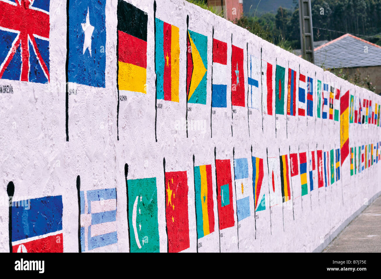 Flags of the World in little harbour Porto de Vicedo in Galicia, Spain - Stock Image