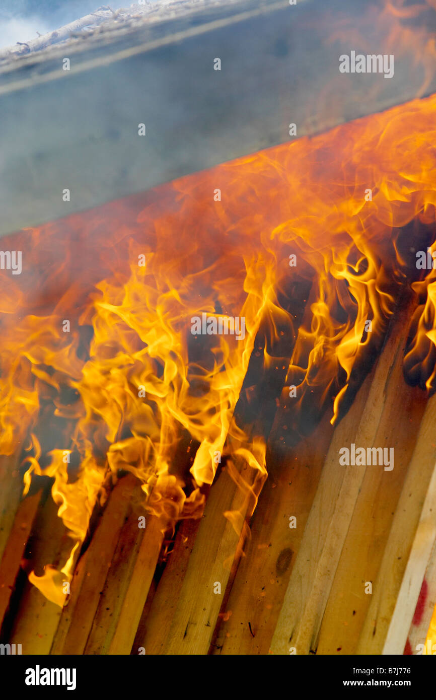 Flames and smoke burn up roof of shed, Hamilton, Ontario - Stock Image