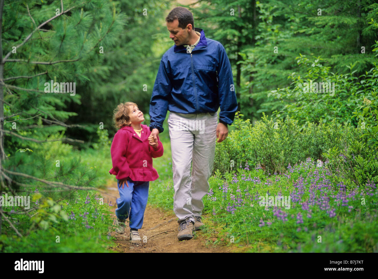 Dad with daughter walking something is