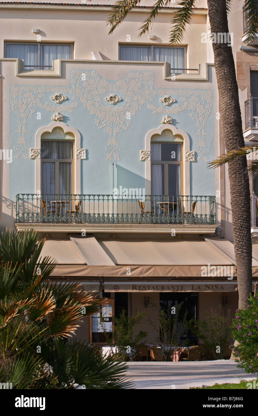 Traditional Catalan architecture buildings by the sea front. Sitges, Catalonia, Spain - Stock Image