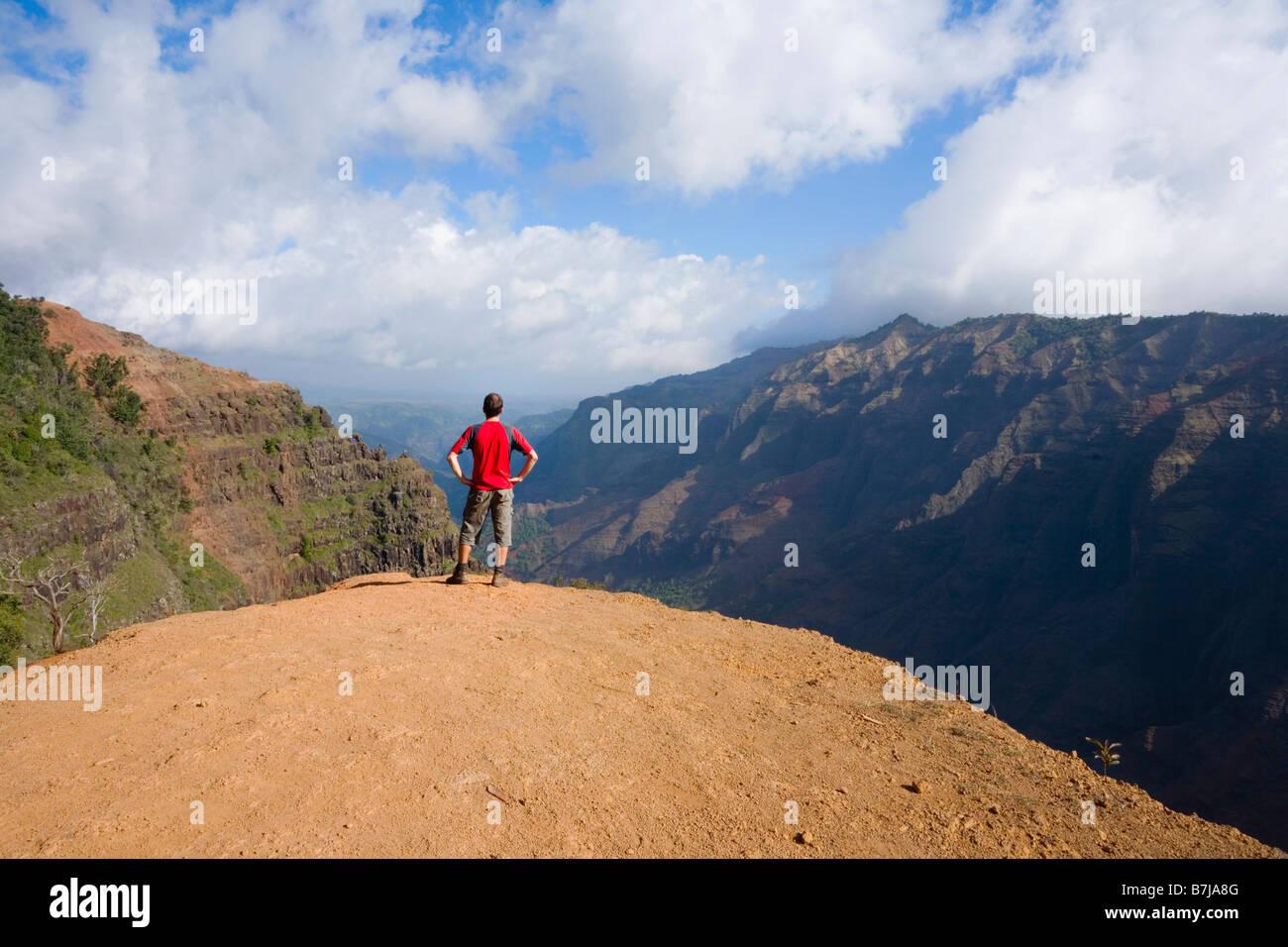 Walker admiring view of Waimea Canyon Waimea Canyon State Park Kaua'i Hawaii USA - Stock Image