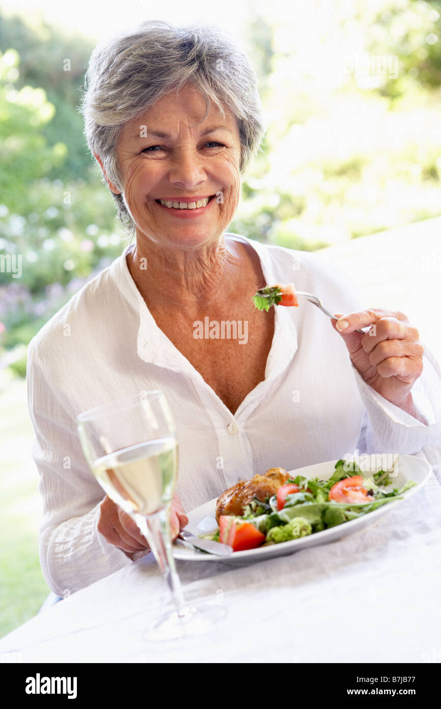 Senior Woman Eating An Al Fresco Lunch - Stock Image