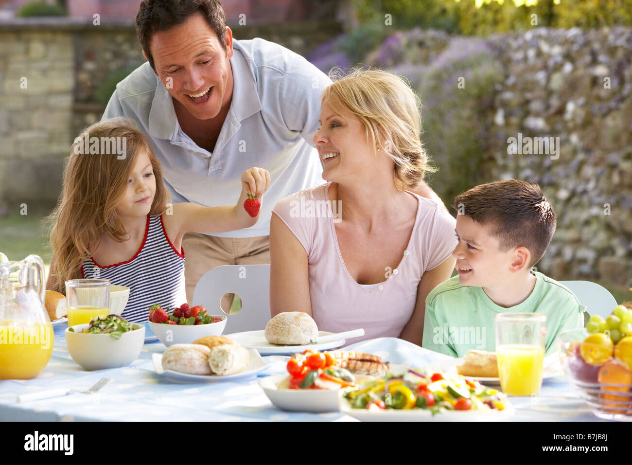 Family Eating An Al Fresco Meal - Stock Image