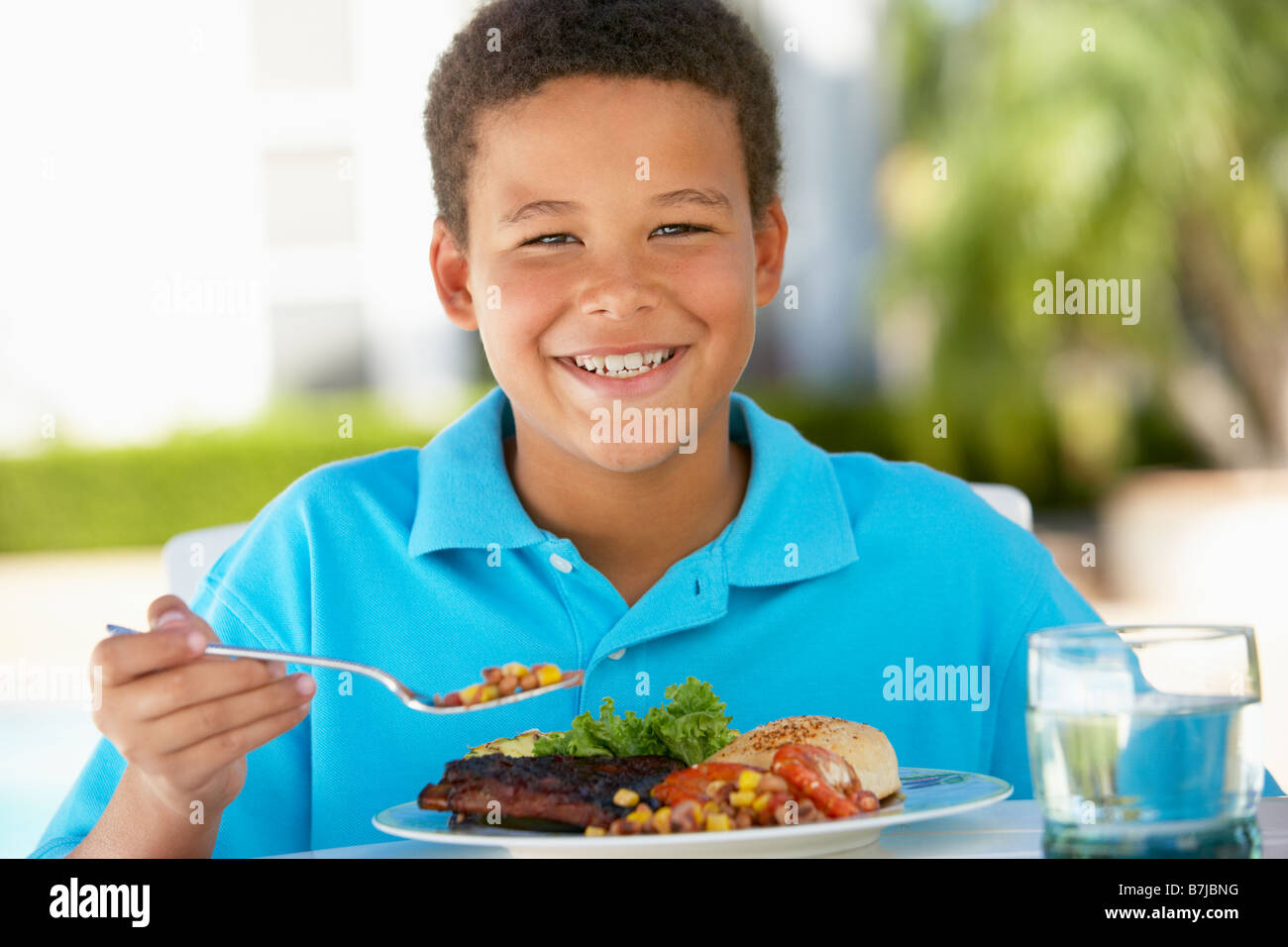 Young Boy Dining Al Fresco - Stock Image