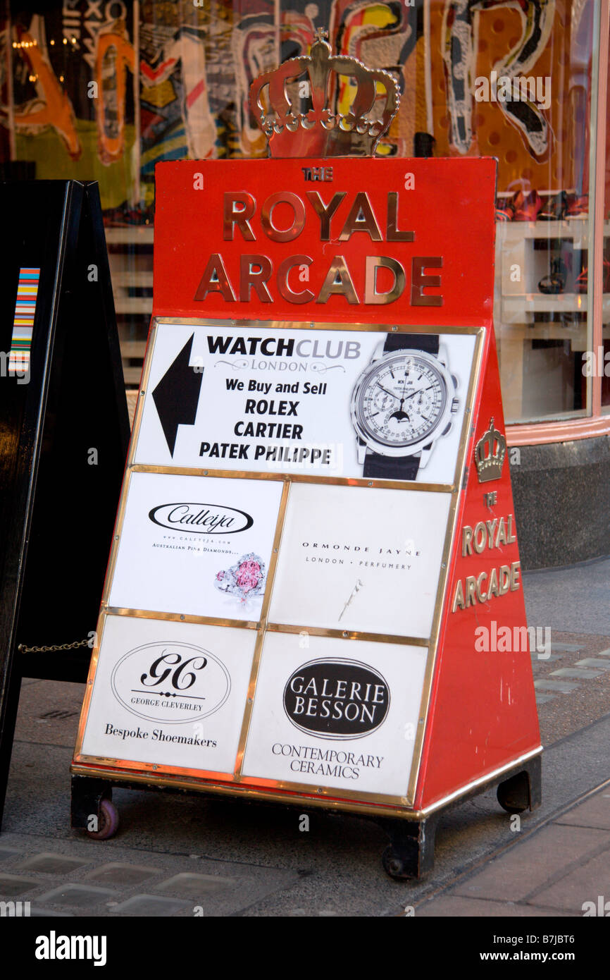 Advertising board outside the Royal Arcade shopping area, linking Old Bond Street to Albermarle Street, Westminster, - Stock Image