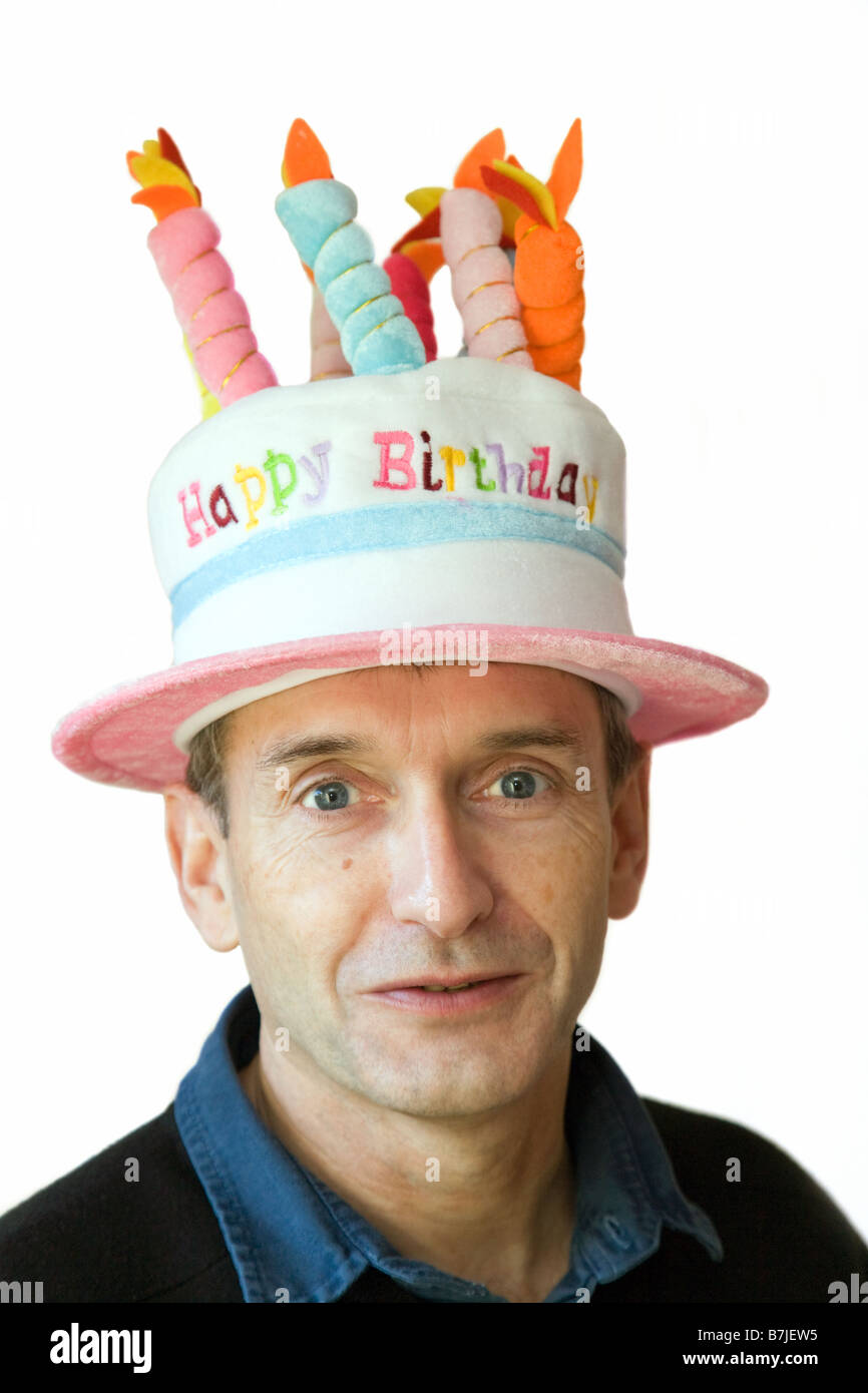 Handsome Middle Aged Man In A Happy Birthday Hat