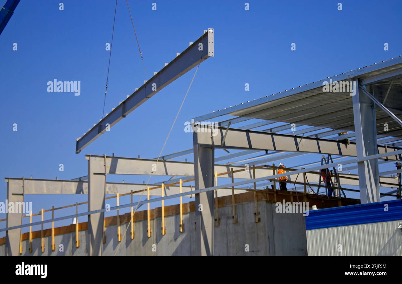 Steel girder being lifted onto roof of building; Canada, Ontario, Hamilton (Composting Facility) Stock Photo