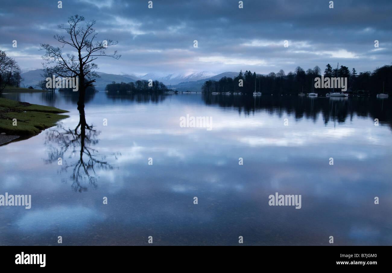 Dawn light on Lake Windermere, the Lake District, Cumbria England - Stock Image
