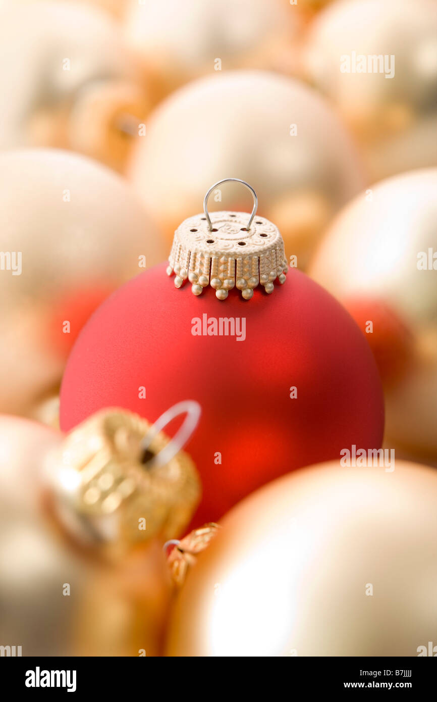 Selection Of Red And Gold Christmas Tree Baubles - Stock Image