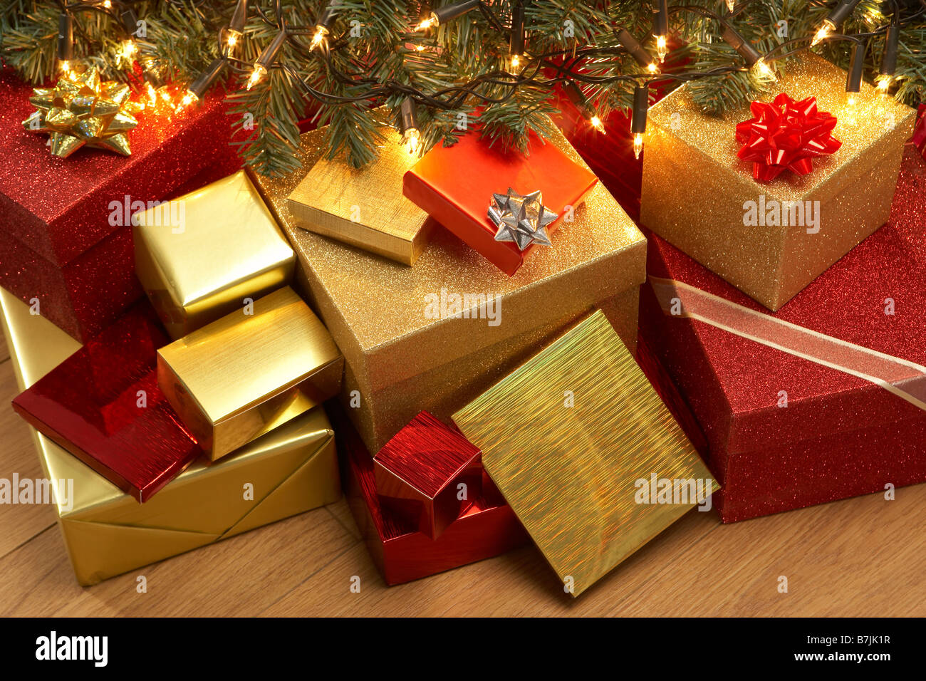 Group Of Christmas Presents Under Tree - Stock Image
