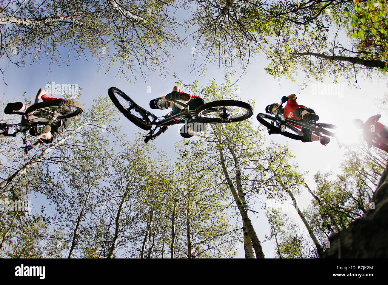 Under a series of bikers mid-jump; Canada Olympic Park, Calgary, AB - Stock Image