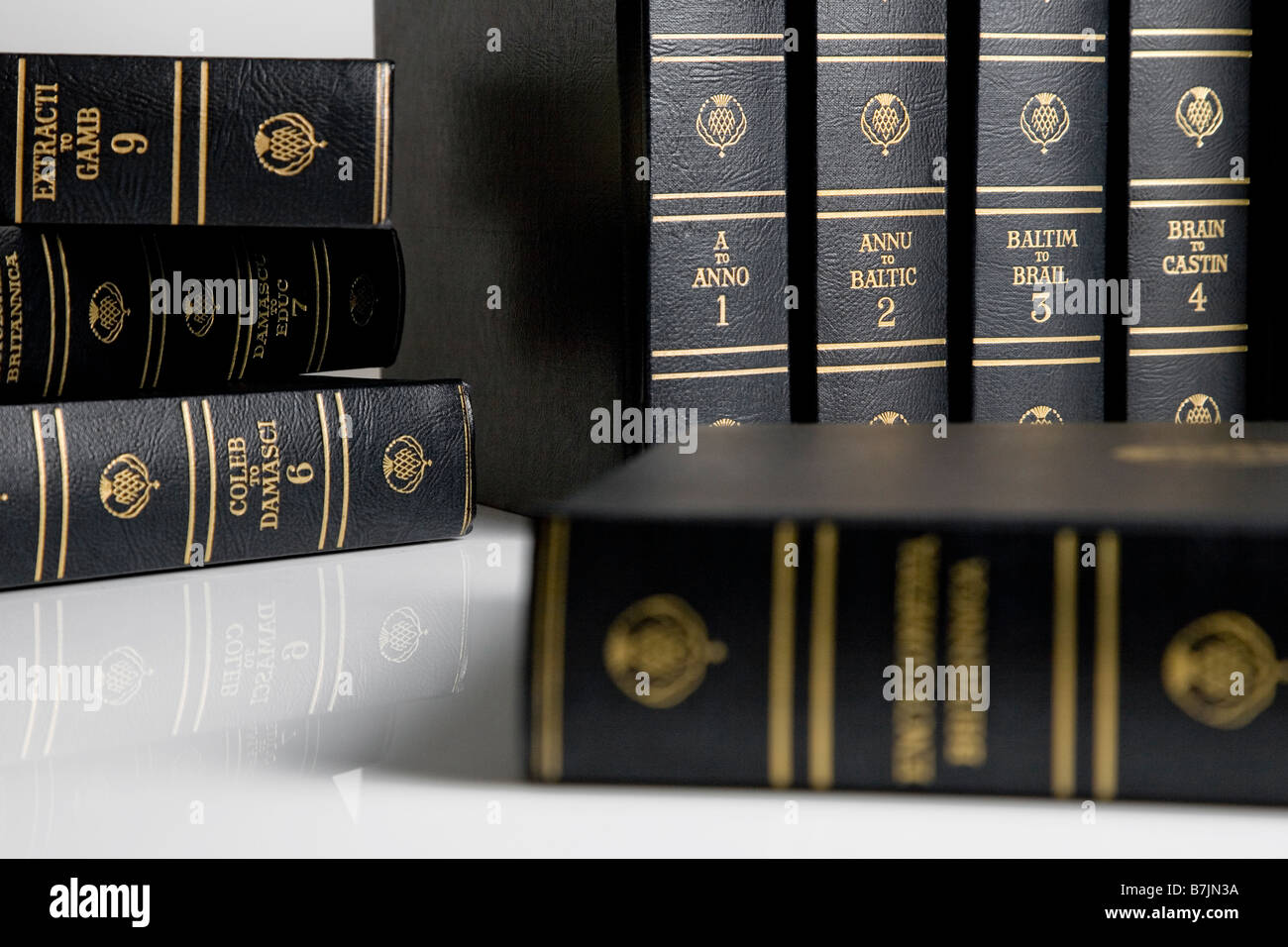 A number of encyclopaedia on a white background - Stock Image