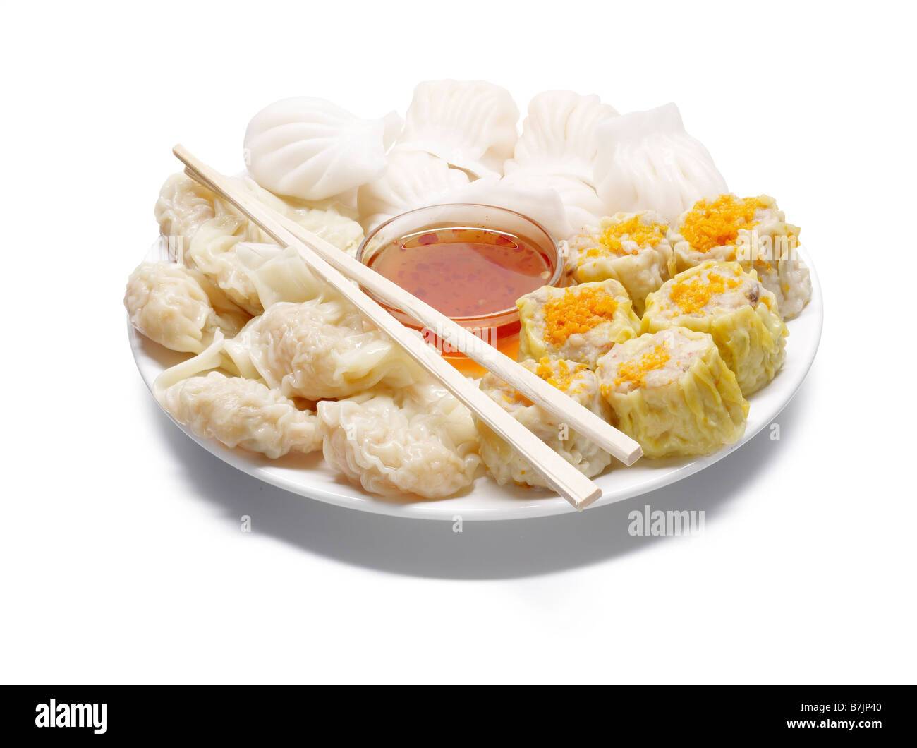 plate of chinese dim sum chilli dip chop sticks - Stock Image