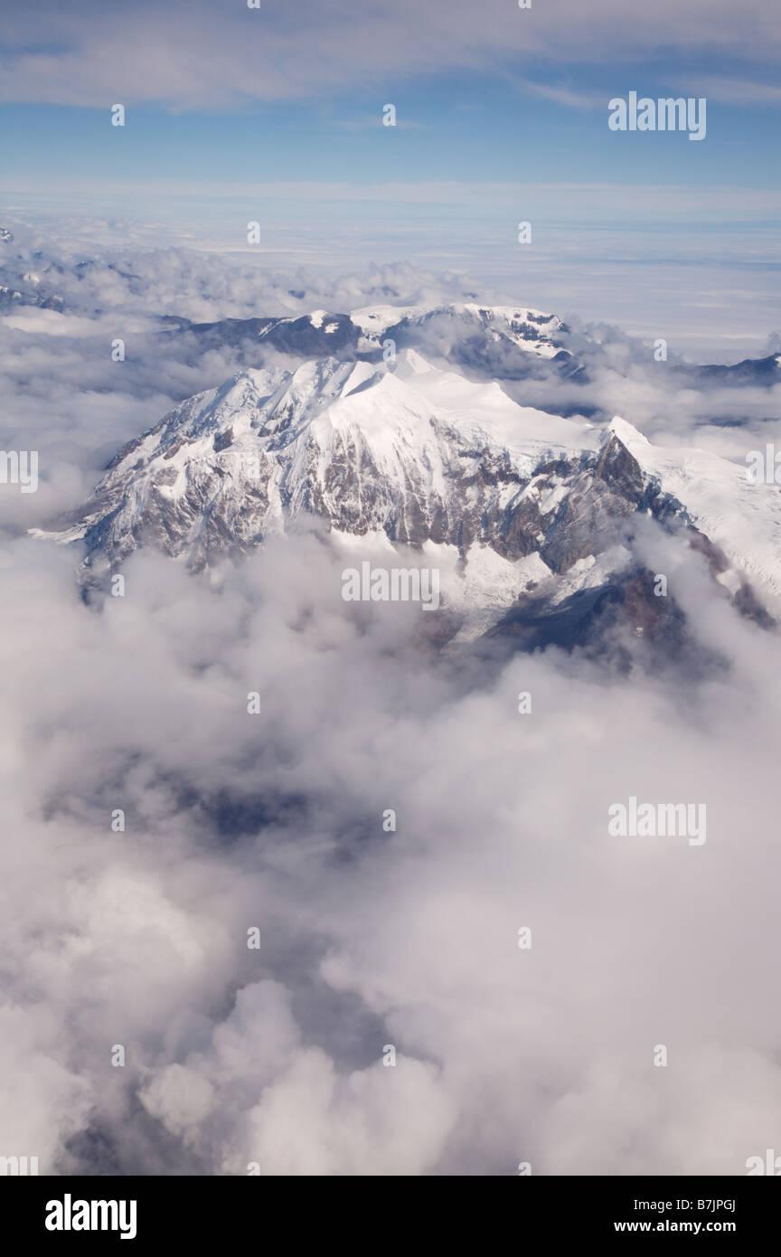 cloudy Aerial Portrait of snowcapped Illimani Mountain Cordillera Real Bolivia - Stock Image