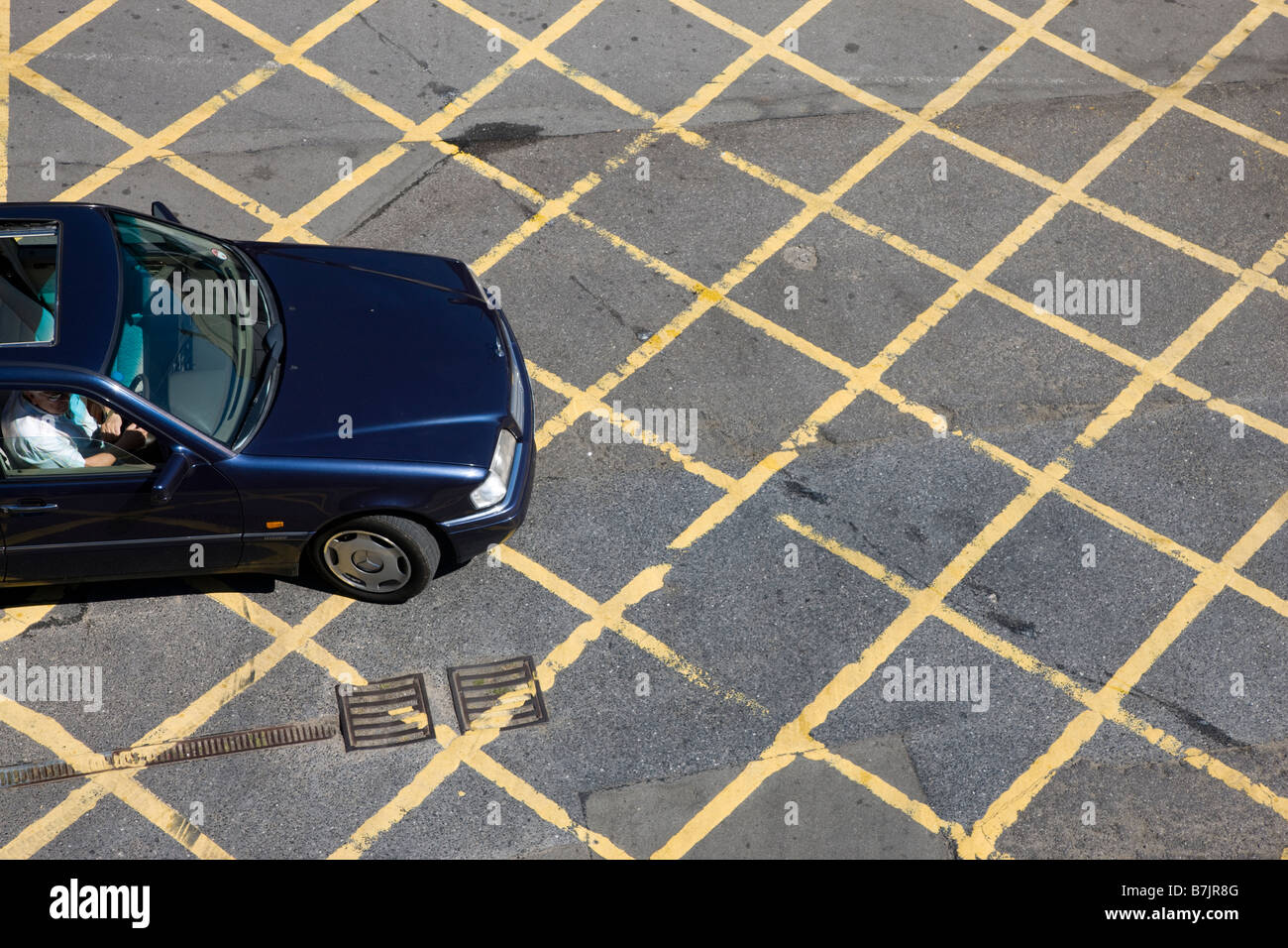 Car entering a road box junction - Stock Image