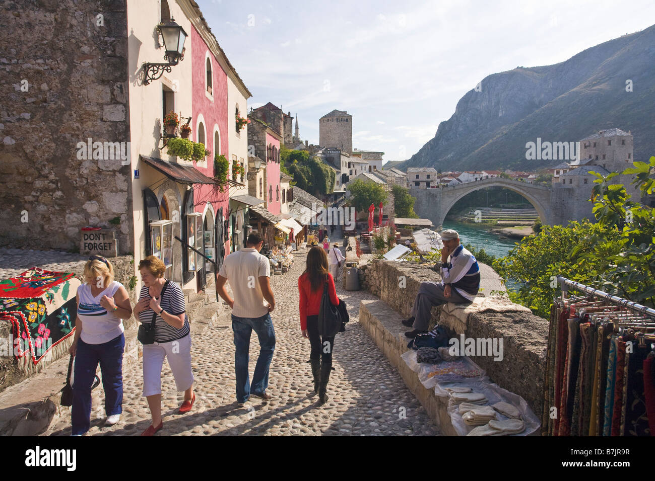 Historic Old Town of Mostar and restored 16th century bridge across the Neretva River in Bosnia Herzegovina Europe - Stock Image
