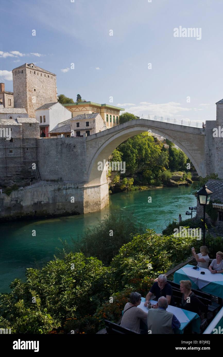Historic Old Town of Mostar and restored 16th century bridge across the Neretva River in Bosnia Herzegovina Europe - Stock Image