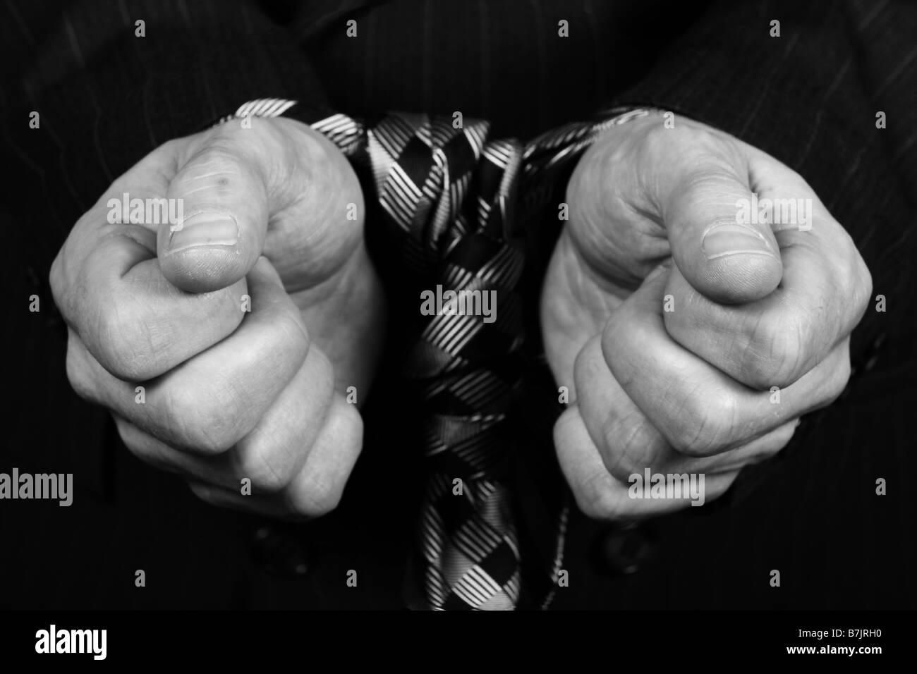 mans hands tied together - Stock Image