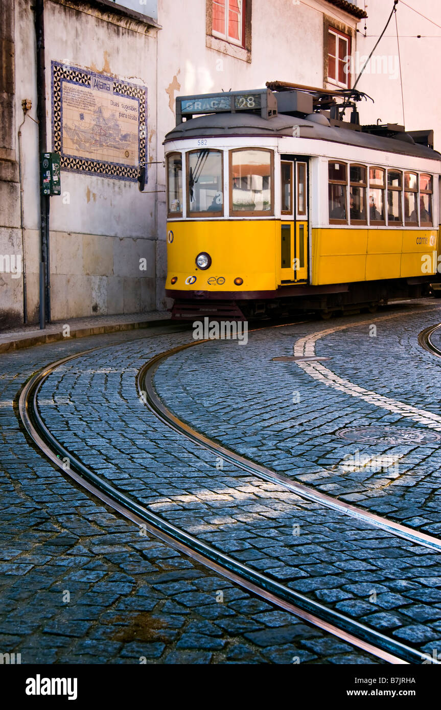 Tram in the streets of the Alfama district of Lisbon - Stock Image