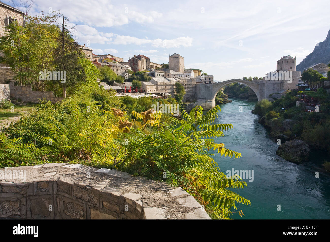 Historic Old Town of Mostar and restored 16th century bridge across the Neretva River in Bosnia Herzegovina Europe Stock Photo