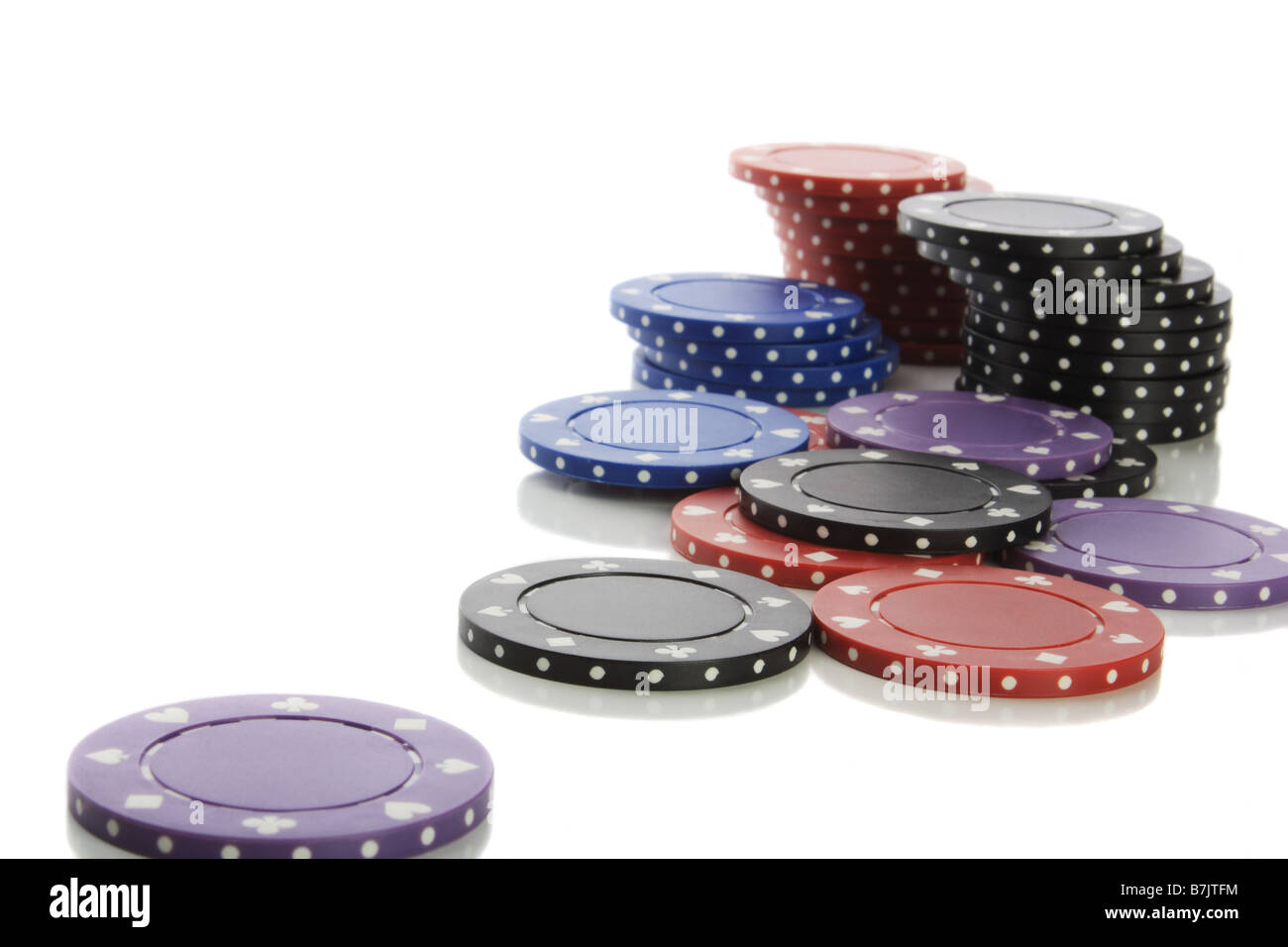 Pile of poker chips isolated on white - Stock Image