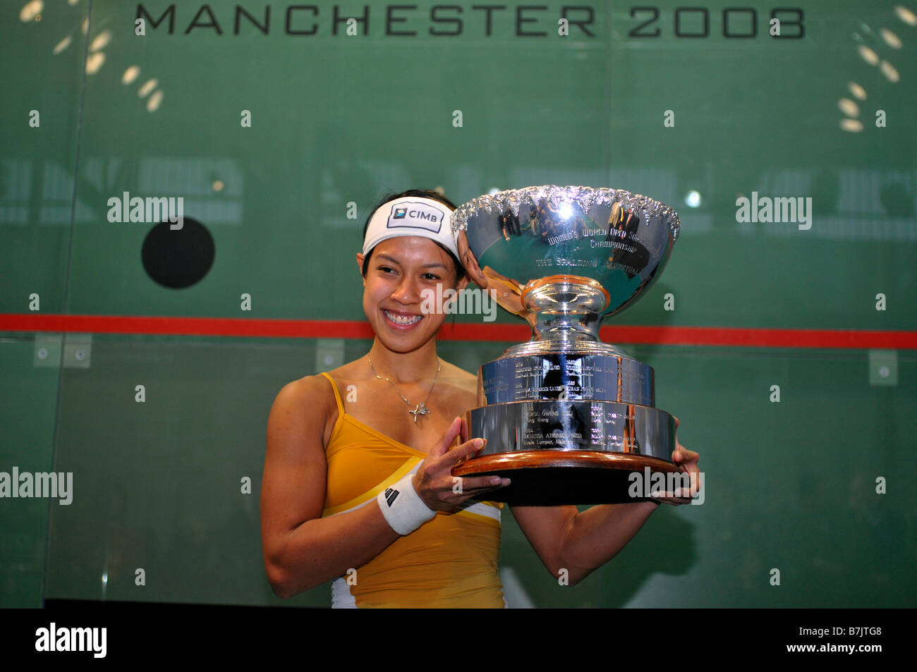Nicol David holds the trophy after beating Vicky Botwright to win the 2008 World Squash Championships in Manchester - Stock Image