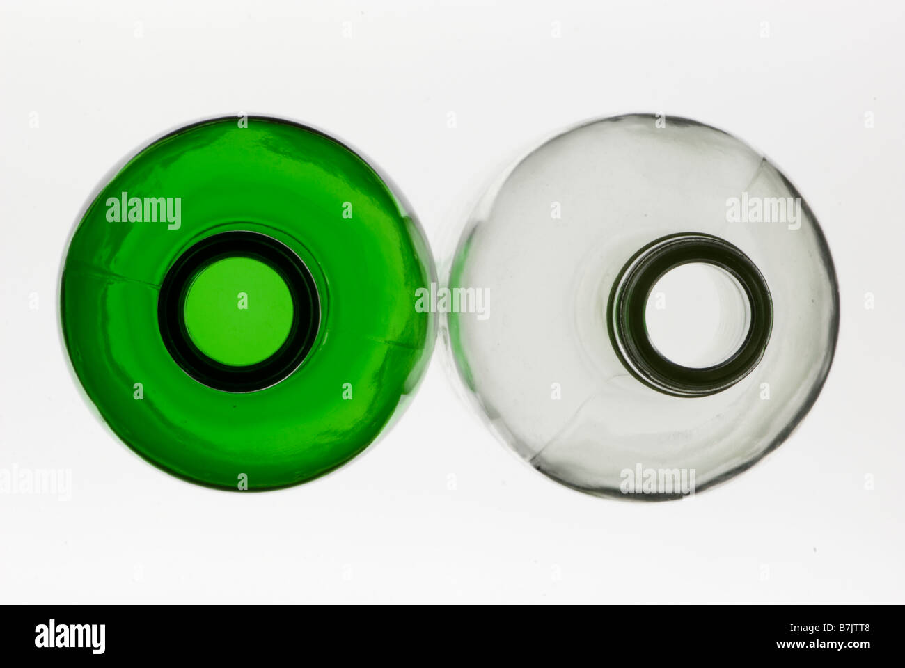 Abstract looking down on top of empty green and clear glass bottles Stock Photo