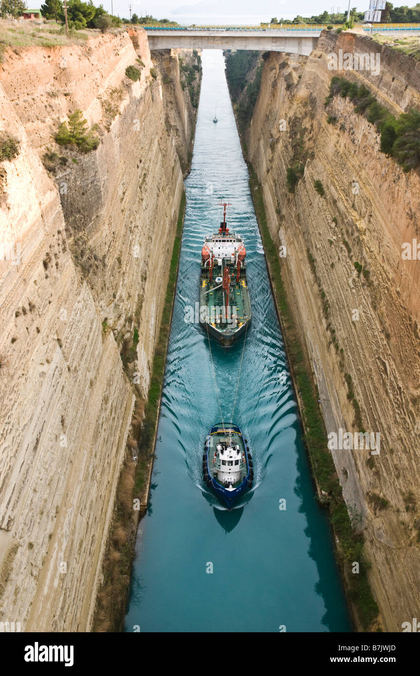A tug pulls a fuel tanker through the Corinth Canal, Peloponnese Greece - Stock Image