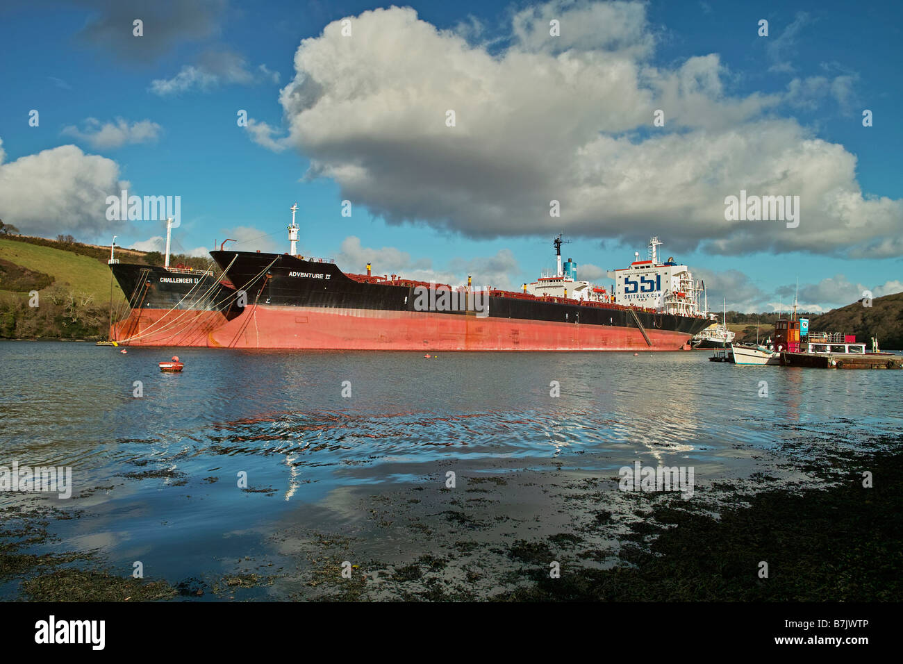 a tanker laid up in deep water on the river fal near truro,cornwall,uk - Stock Image