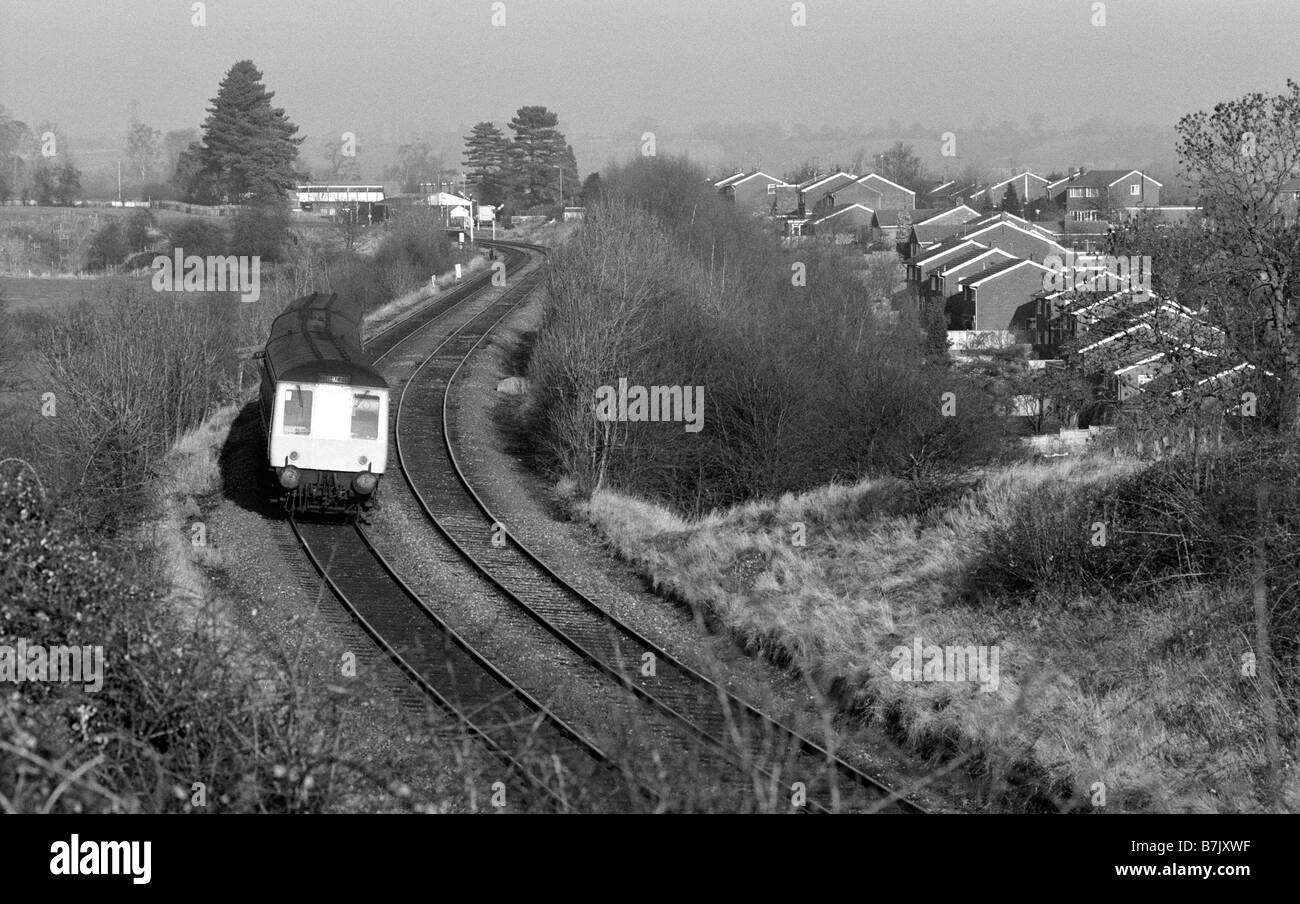Train and housing in 1987, UK - Stock Image