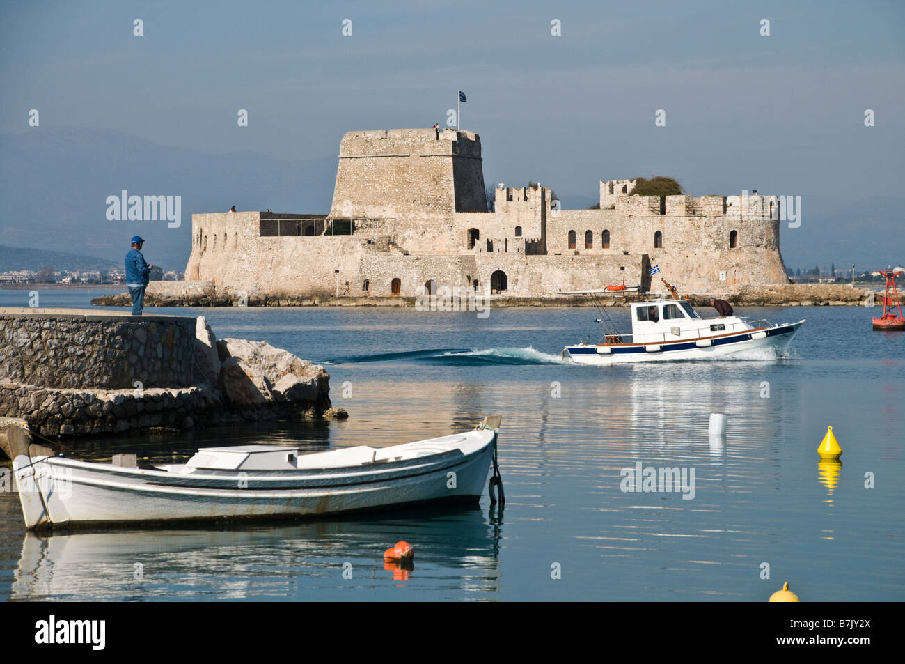 The harbour at Nafplio with the Bourtzi island and fort in the background Argolid Peloponnese Greece Stock Photo