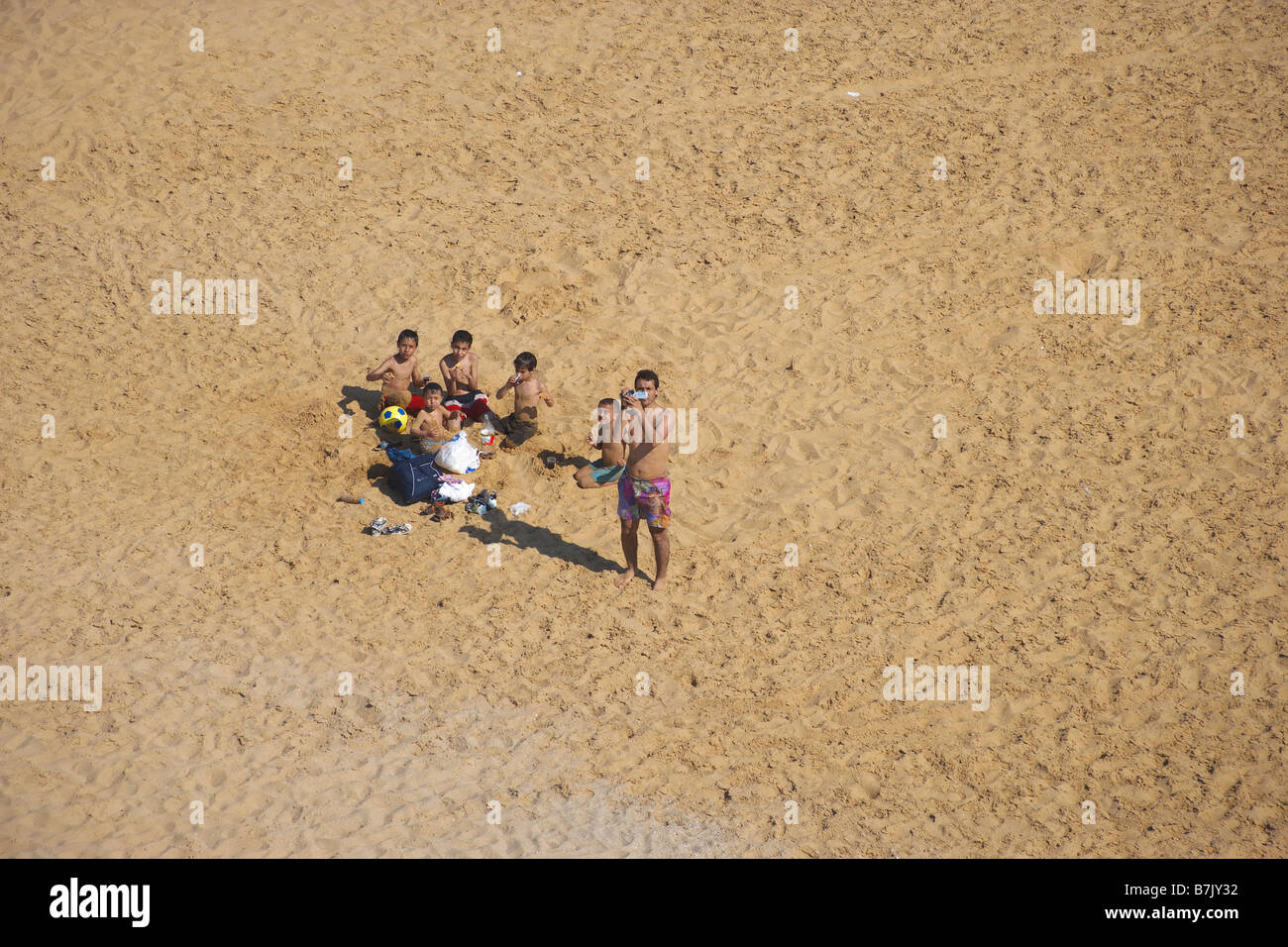 Aerial view of a young boys picnicking at a beach on the Black Sea coast of Istanbul Turkey - Stock Image