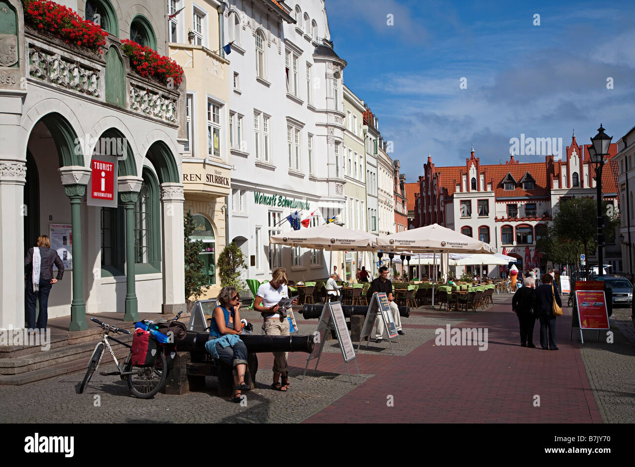 People outside tourist information office Wismar Germany - Stock Image