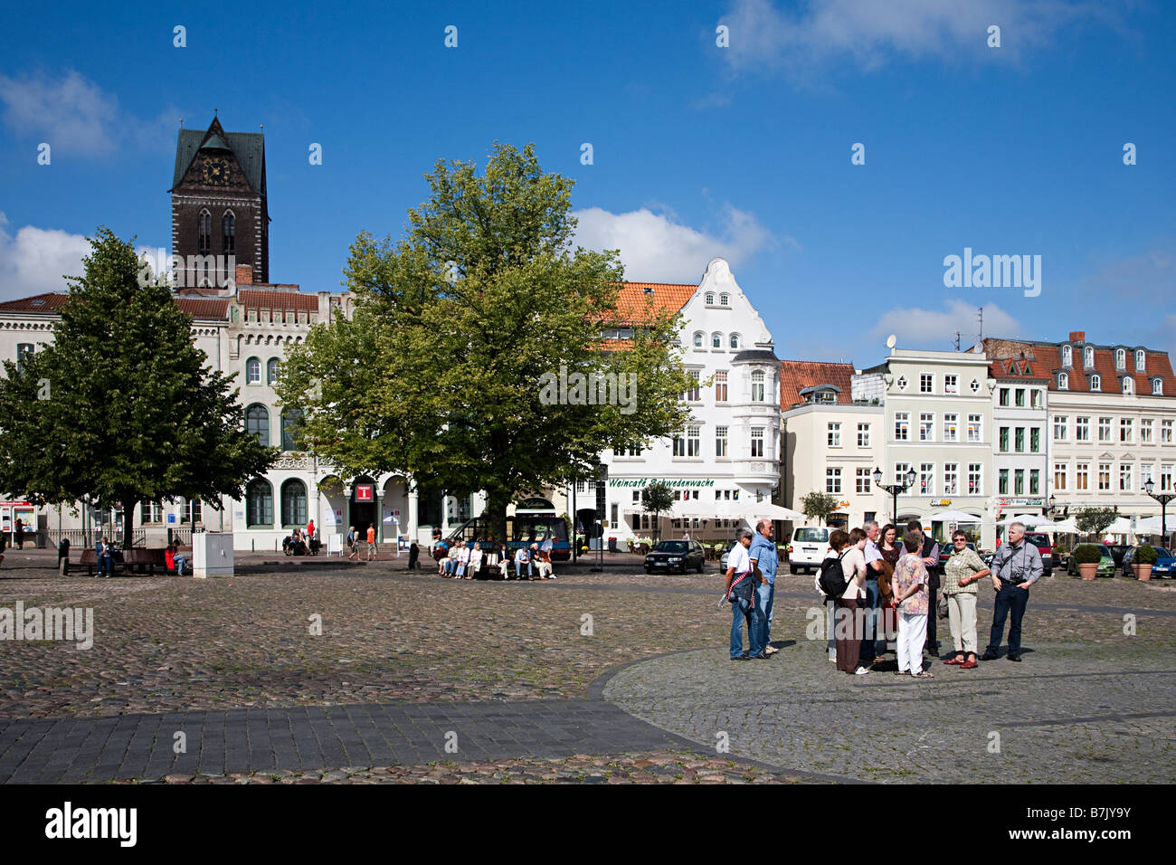 Tour group in main square Wismar Germany - Stock Image