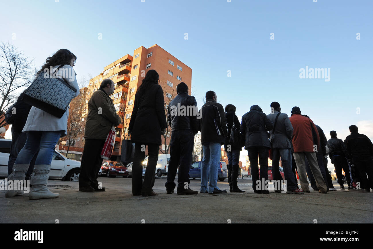 People queue up at a job center in Madrid Spain - Stock Image