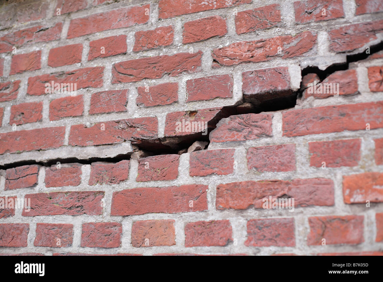 Crack in a brick wall - Stock Image