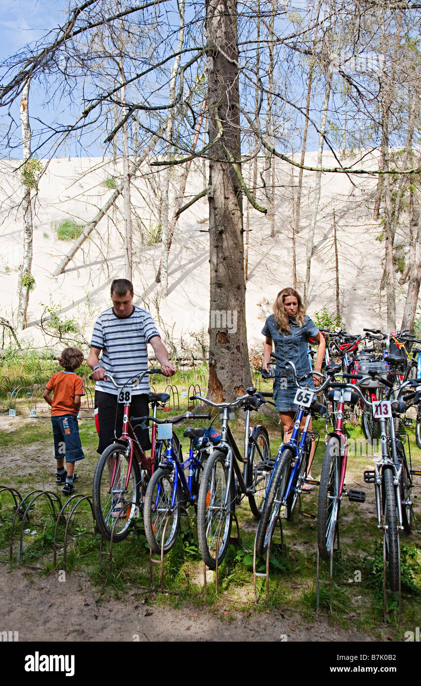 People with bicycles for hire in Slowinski national park Leba Poland - Stock Image