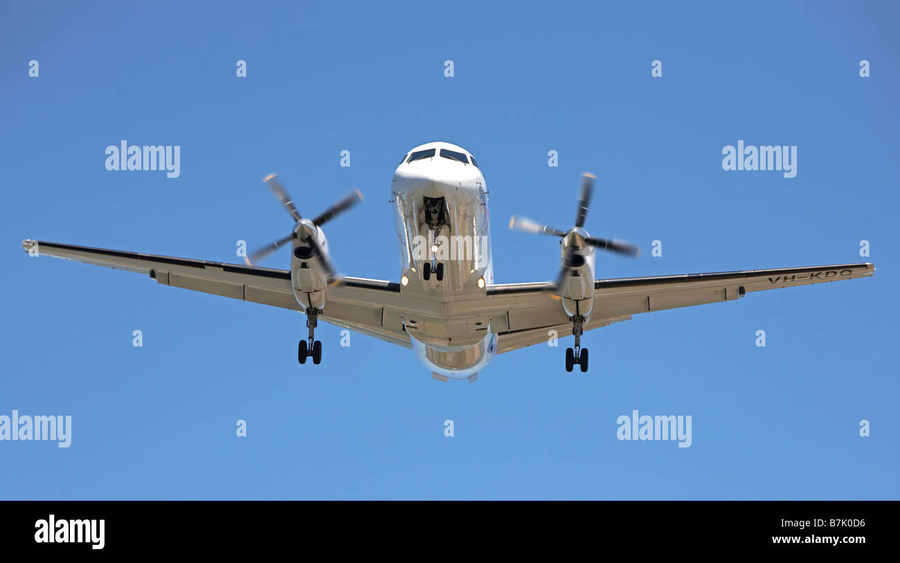 Twin engined propeller aircraft coming in to land - Stock Image