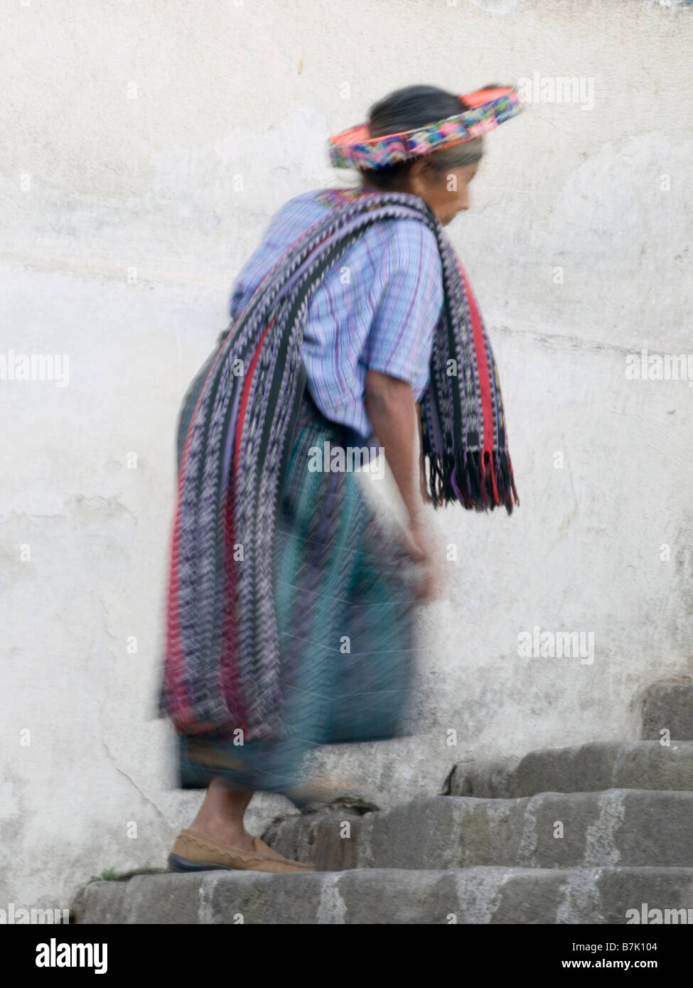 Villagers walking up church stairs - Stock Image