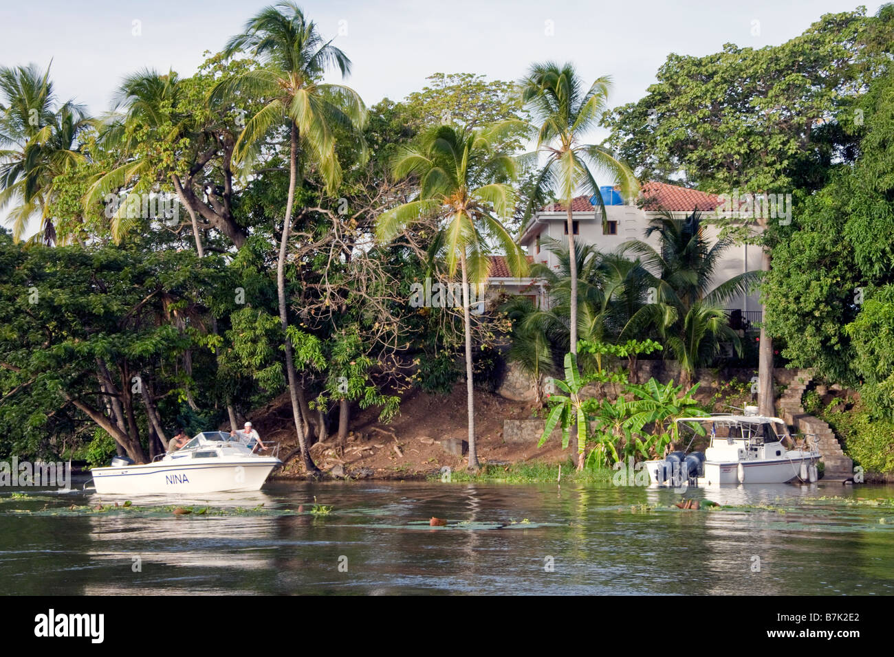 Isletas de Granada, islands in Lake Nicaragua with private home and boaters Stock Photo