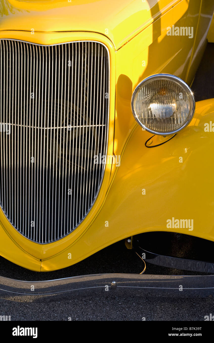 Detail of the front end of a bright yellow hot rod Stock Photo
