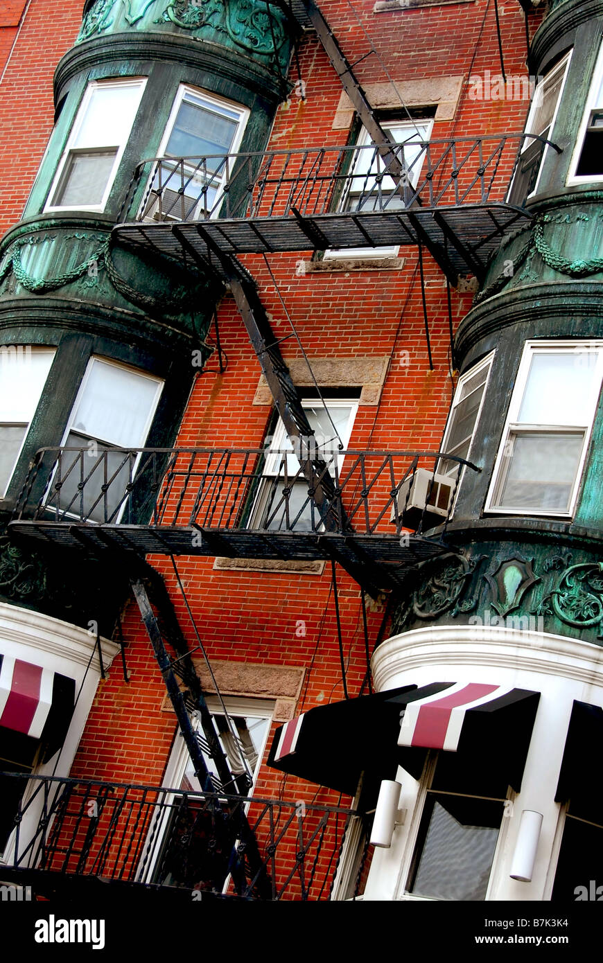 Lovely Fragment Of A Red Brick House In Boston Historical North End With Wrought  Iron Balconies And Fire Escapes