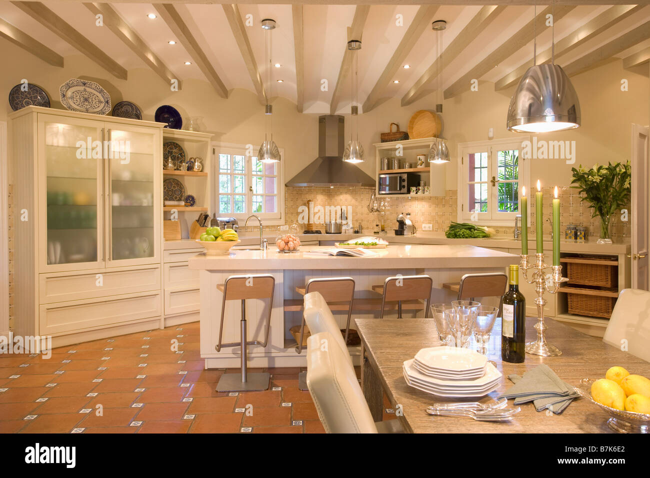 Large Openplan Kitchen Dining Room With Glass Fronted Cupboard Stock - Light above kitchen table