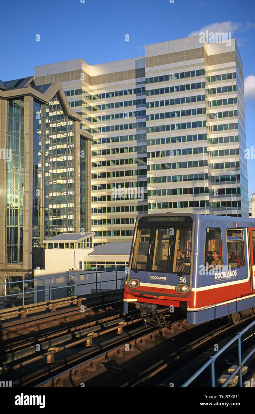 London, Docklands, DLR train on S-bend passing South Quay Plaza. - Stock Image