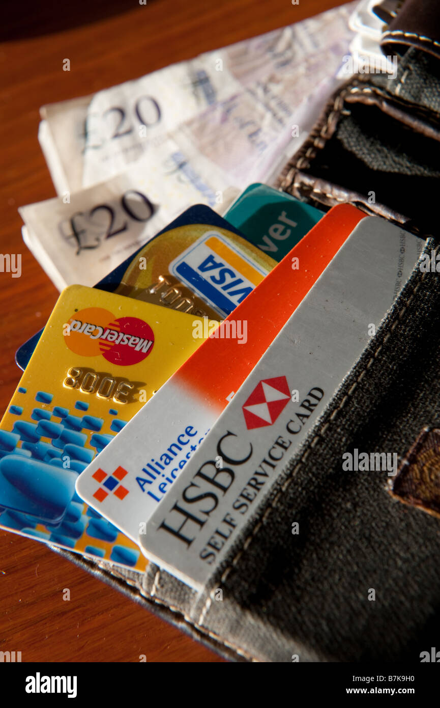 A man s wallet with credit cards and cash UK - Stock Image