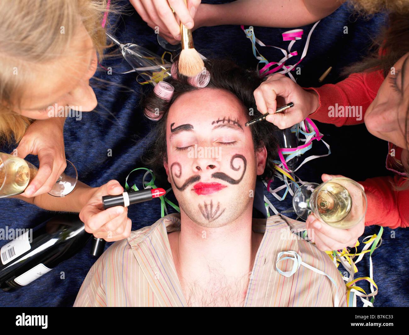 girls making up sleeping friend Stock Photo