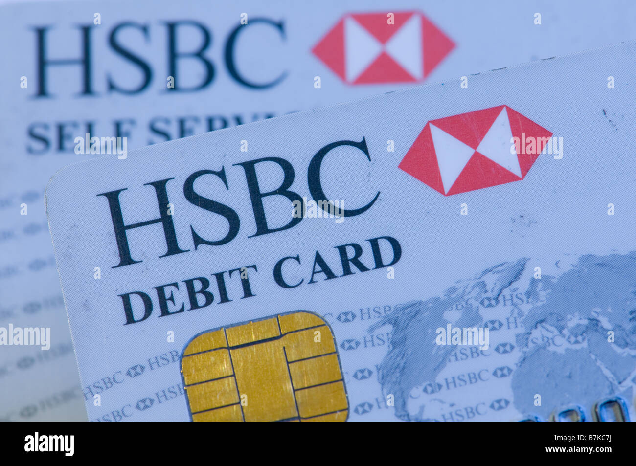 HSBC bank self service ATM and debit cards UK Stock Photo