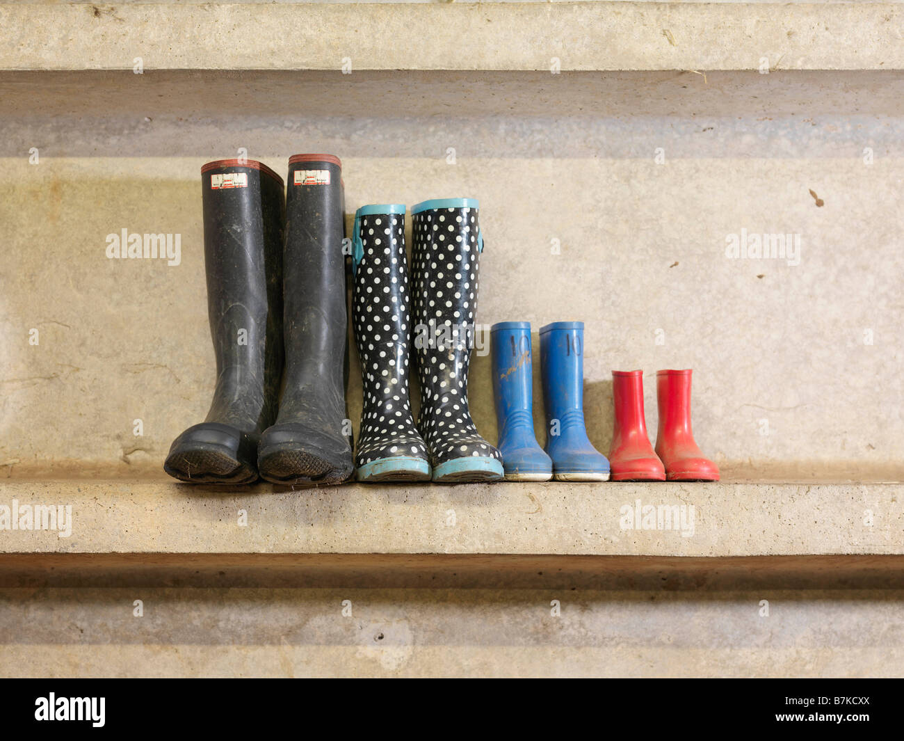 Four Pairs Of Wellington Boots - Stock Image