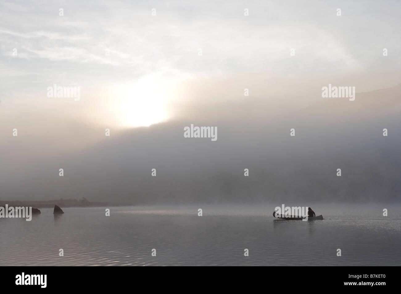 Kayaking in the morning mist. - Stock Image