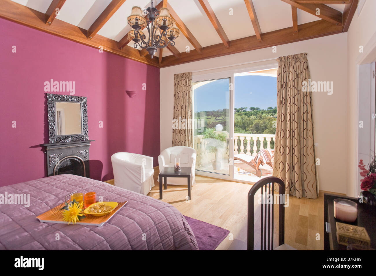Mauve Quilt On Bed In Pink Bedroom Overlooking Terrace In Spanish